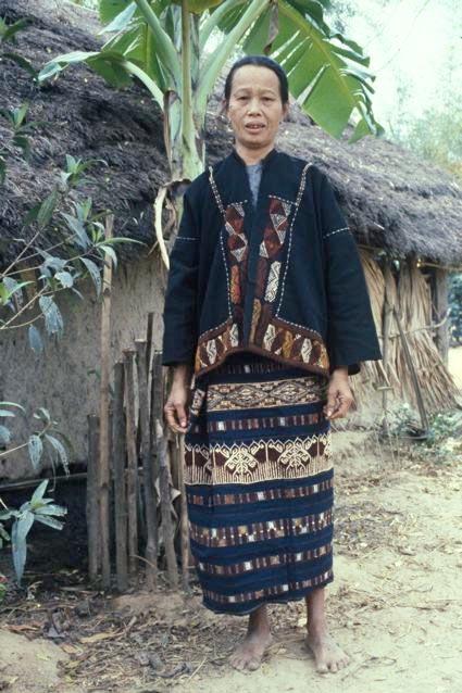 Matron models her heirloom suit, Hainan Dao, 1983